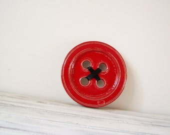 Red button wall sculpture, earthenware clay wall hanging of scarlet button with dark wooly yarn, Greek pottery ceramic button for the wall
