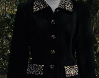 Shape fitting black jacket with leopard accents by  designer Jennifer Jeffries sophisticated and a bit sexy