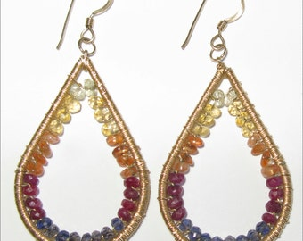 Gold filled, lemon quartz, citrine, sunstone, rubbies, and iolite earrings.