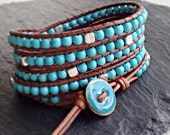 Wrap bracelet with natural turquoise and tibetan silver beads on a vintage brown leather cord