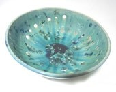 Ceramic blue and green  fruit bowl with small holes to allow air circulation for freshness