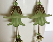 Spring green lucite flower earrings with swarovski accents and brass bead caps