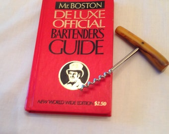 Mr. Boston Bartenders Guide 1974 and Corkscrew with Bakelite Handle
