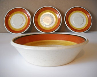 Set of 3 saucers and 1 bowl