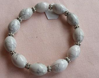 Silver & white oval beaded bracelet