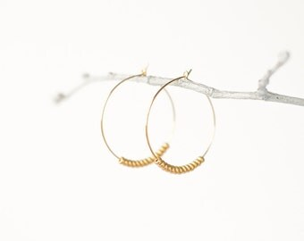Gold circle earrings with gold beads