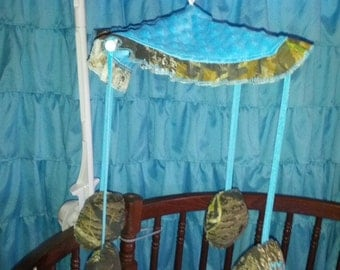 Crib mobile in mossy oak with animals face