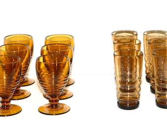 Two Vintage Sets of Amber and Smoke Colored Horizontal Ribbed Goblet and Tumbler Glasses Drinkware