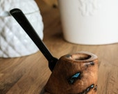 Turquoise inlaid gmelia burl pipe