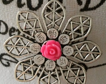 Ball chain necklace with a metal flower pendant and pink cabochon rose