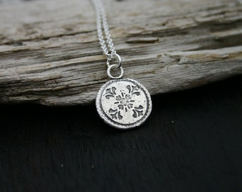 Sterling silver round disc pendant necklace.  Flower textured nature disc necklace with sterling silver chain. Handmade, unique, rustic .