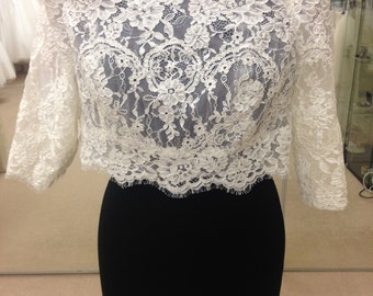 Lace off the shoulder wedding bolero with tiny buttons down the back and 3/4 length sleeves
