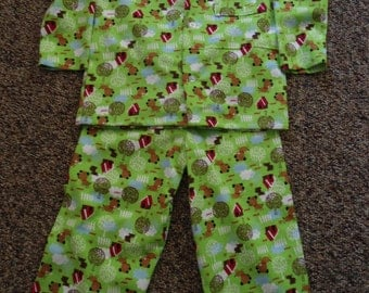 Size 6 Boys Pajamas with brown dog, red dog house white trees and fence on green
