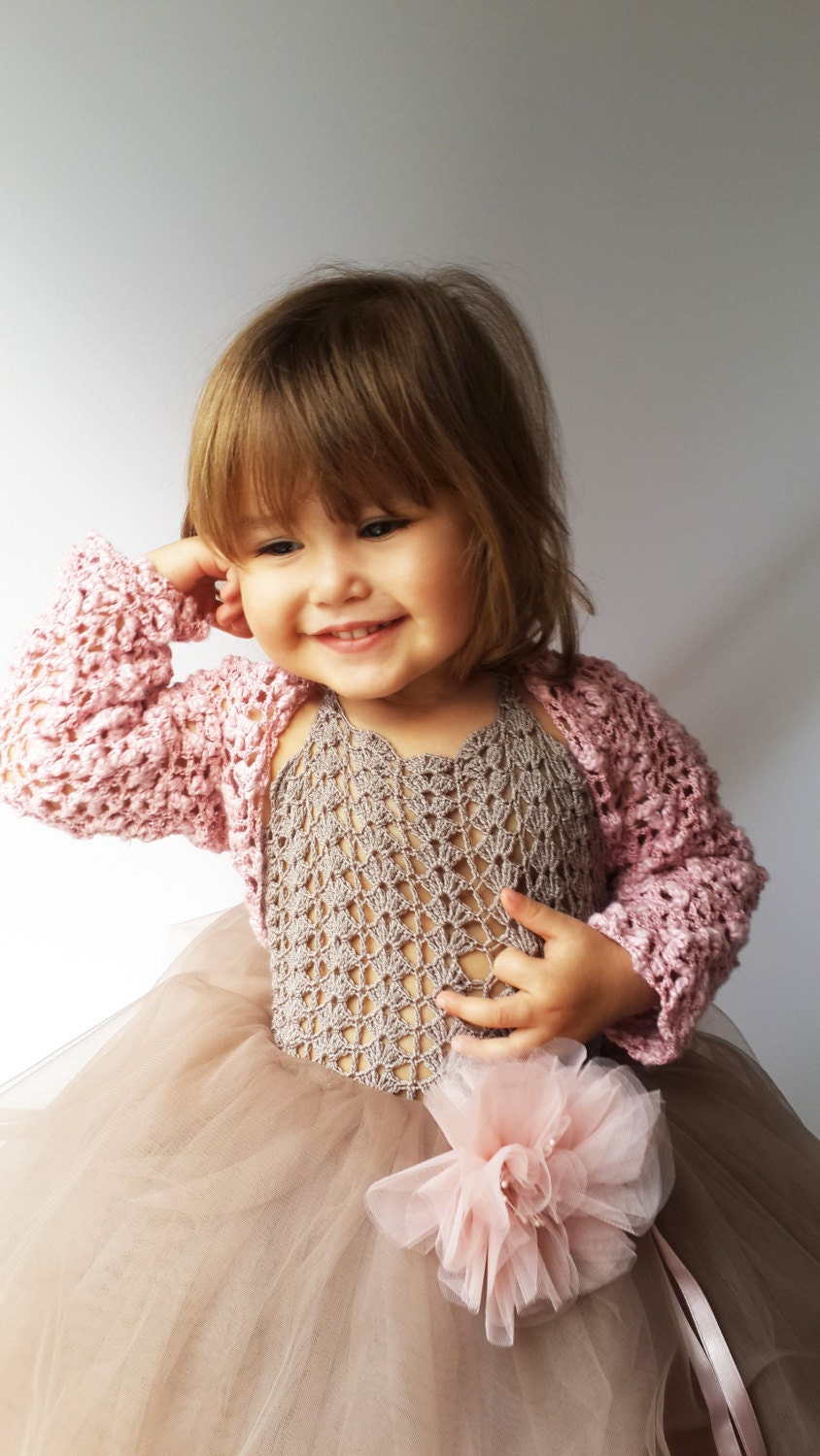 Explore crop-length cover-ups from zulily for glam little girls. She'll be set for the occassion in dressy bolero jackets with long or short sleeves.