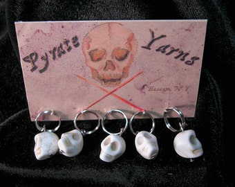 Large White Skulls.  5 stitch markers on 9mm rings.  Fits needles up to size 13US