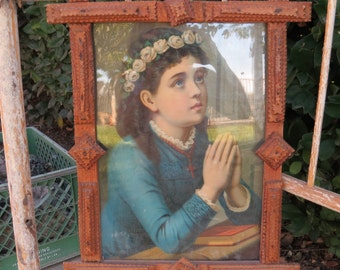 Antique tramp art frame chrome lithograph from Alsace Lorraine France, young girl with folded hands praying, wearing wreath of white roses