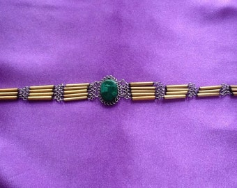 Early porcupine quills like choker/necklace with green stone.