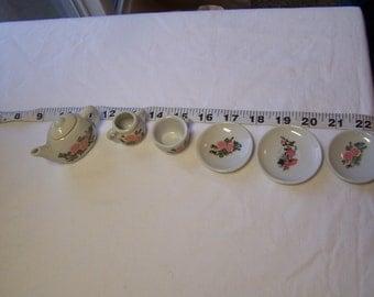 7 pieces of a rose tea set