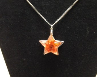 Real Marigold in a resin star.