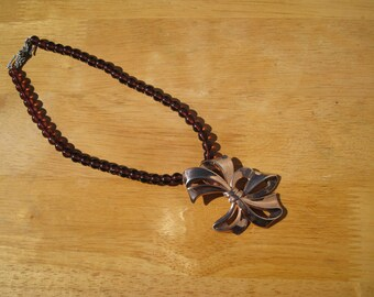 one of a kind necklace in rose gold over sterling and garnets