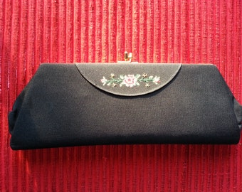 Stylish vintage clutch in black with embroidered flowers