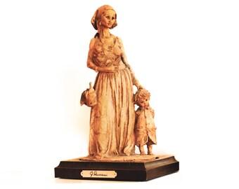 G.Armani Terracotta figurine poor woman & children