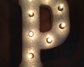 Large metal letters with lights