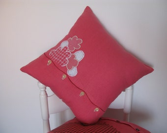 Pink linen decorative pillow embroidered by hand