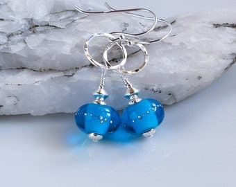Turquoise silver dot handmade lamp work glass earrings , Turquoise and fine silver handmade lampwork glass earrings, turquoise, silver drops