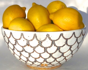 Large handmade ceramic bowl in gloss white with iron-oxide design