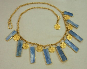 Shades of the ancient Aegean in a lavish charm necklace of raw blue kyanite & 24k vermeil