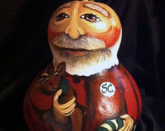 A Big Bald Santa Claus Hand Painted Gourd in his long johns