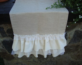 Burlap table runner with two white cotton ruffles and a single lice ruffle
