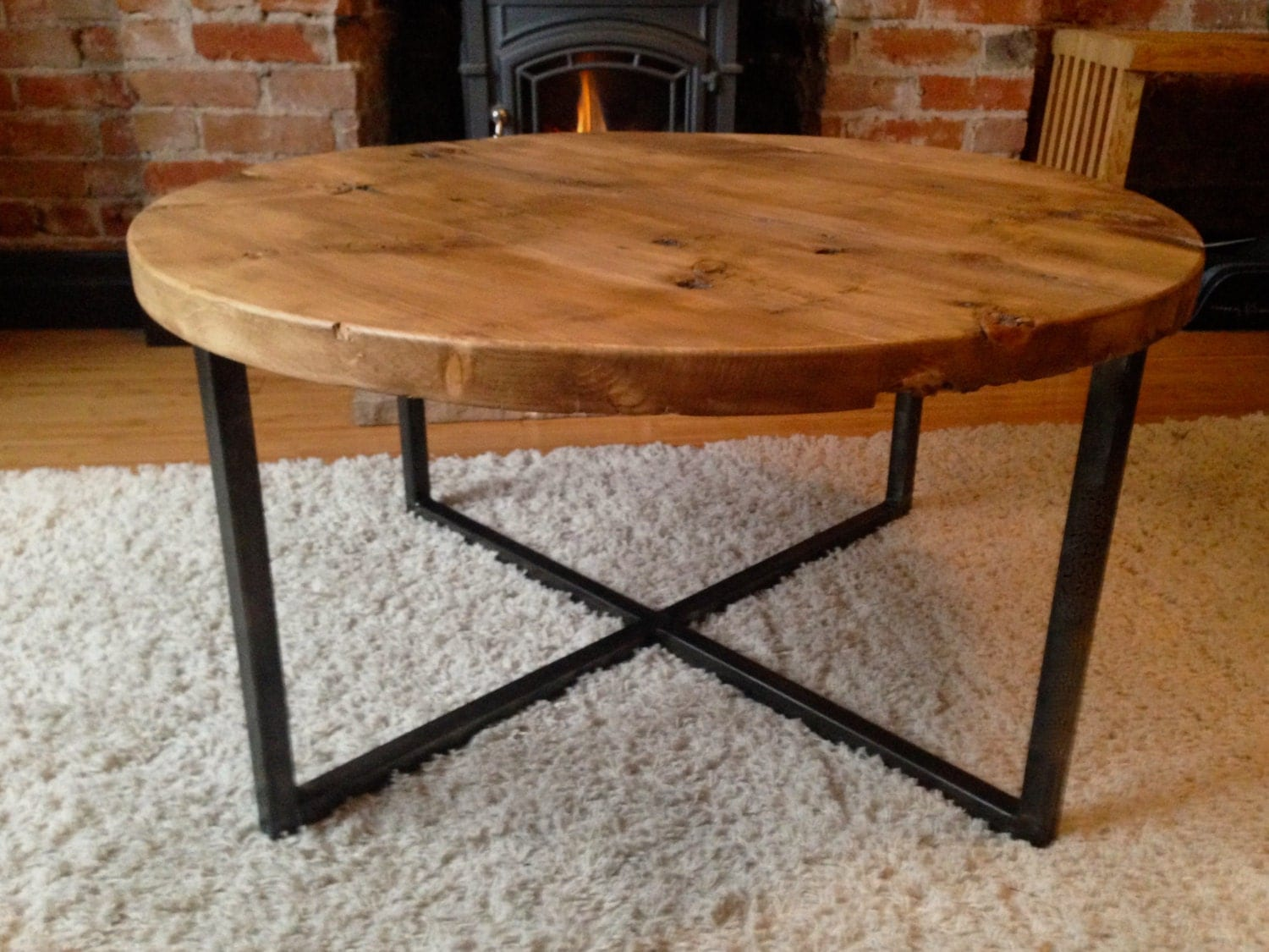 Reclaimed barn wood round coffee table with metal base Recycled wood coffee table