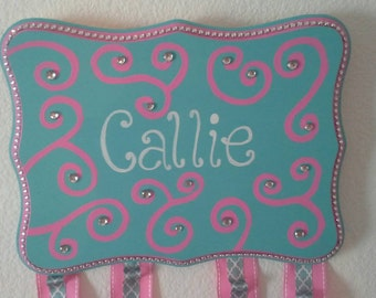 Girls Bow Holder, swirls in pink with aqua and crystal detail. Personalized name, ribbon w/ loops, custom made piece, showcase her bows!