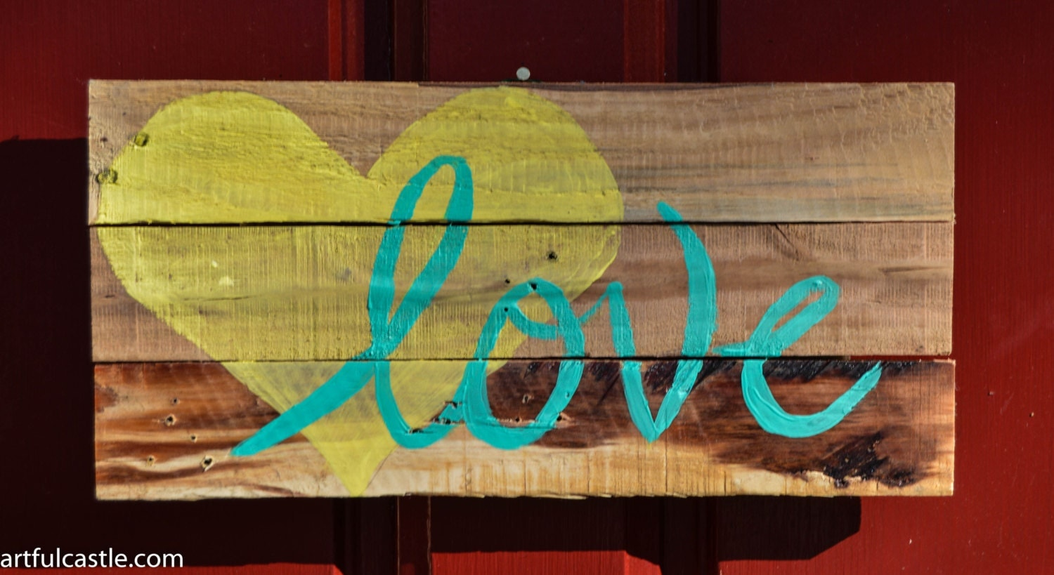 Reclaimed wood sign with yellow heart and teal