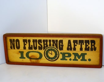 NO FLUSHING AFTER 10p.m. Wooden wall-hanging