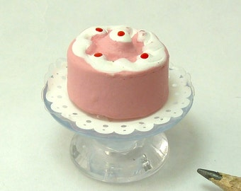 pink cake on doily and stand dollhouse miniature 1/12 scale
