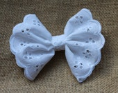 "4.5"" white eyelet bow on clip or headband, made to match Well Dressed Well Dressed Wolf's Aunt Heart Dresses."