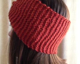 Hand knit headband in burnt orange color