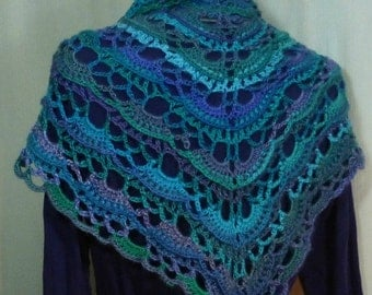 Crocheted shawl or scarf in blues, purples & greens