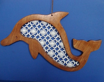 Wooden wall hanging dolphin with a lace inset.