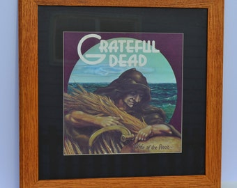 "Grateful Dead ""Wake of the Flood"" album with oak frame and black matte, vinyl music art, album art, framed music, wall art, rec room art"