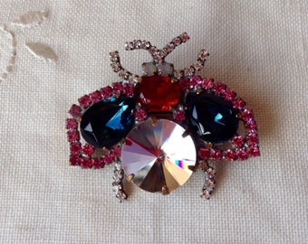 Cute vintage sapphire blue,clear,red and pink fly rhinestone  brooch