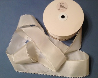 """Vintage white Ribbons with a Picot Edge.Made in Switzerland , Width: 2 1/4"""" wide , Sold by the Yard."""
