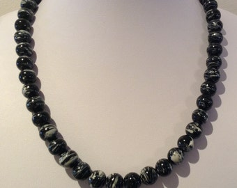 Necklace. 49-50cm. Featres 10mm round Glass beads. Black and white Multi striped patterns