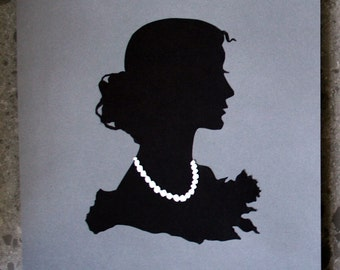 Hand-cut paper silhouette, 'Hers' black & white, lady with pearls, on gray 8.5x11 paper, original artwork