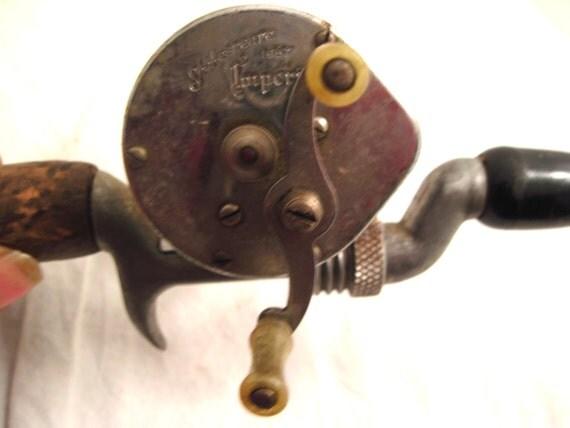 Antique steel fishing rod reel shakespeare decor pole for Reel steel fishing