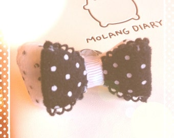 Kawaii ring with a black and white bow