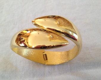 Gold tone bangle